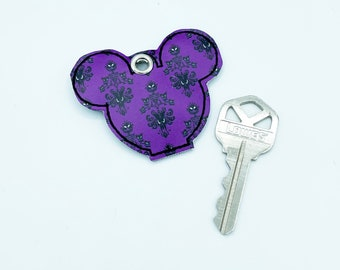 mouse head key topper with Haunted Mansion Wallpaper theme