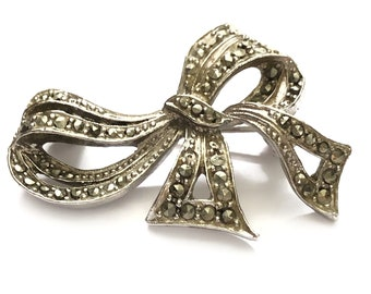 Vintage mid century faux marcasite bow brooch.