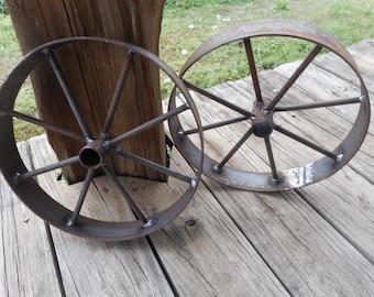 "A pair of 12"" wagon wheels , rustic art Bar b que pits wagons etc,"