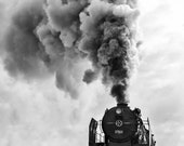 A Steam Train With Authentic Retro Wagons Passes Over an Old Arch Bridge. Lots of Steam and Beautiful Clouds. Black and White Photography.