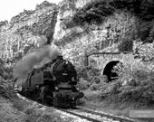 A Restored Stream Locomotive 46.03 Passes In Front of a Tunnel Among Rocky Mountains. Steam Train. Black and White. Download. Wall Decor.