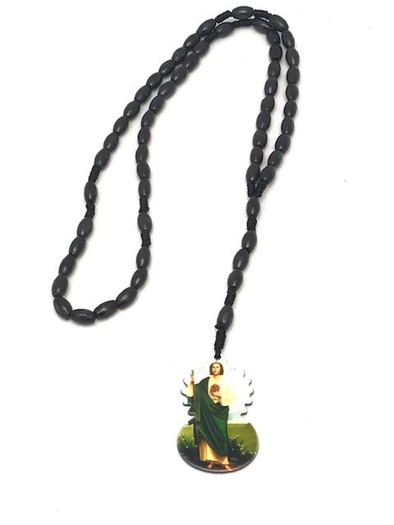 Beautiful black wood stones with Jesus charm rosary style necklace