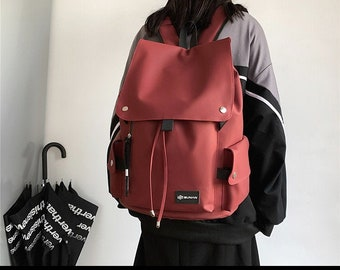 large capacity travel backpack,student backpack,schoolbag,solid color simple backpack