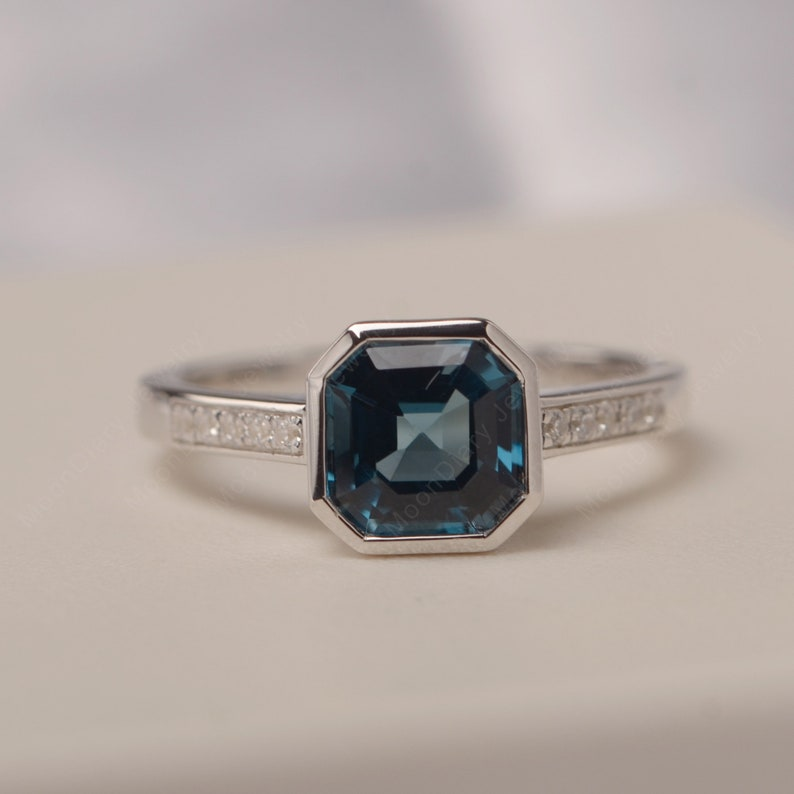 Asscher cut London blue topaz ring bezel setting November birthstone engagement ring for women