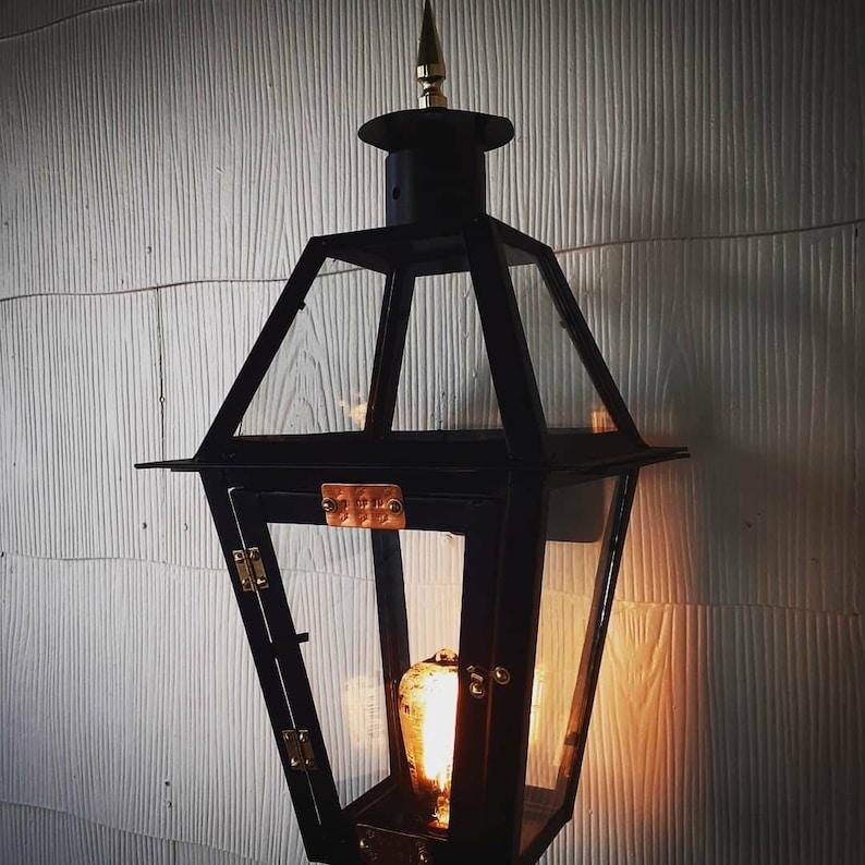 Dark City 1 of 10 wall mount lantern.