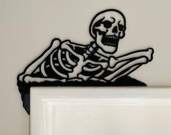 Skeleton door frame art