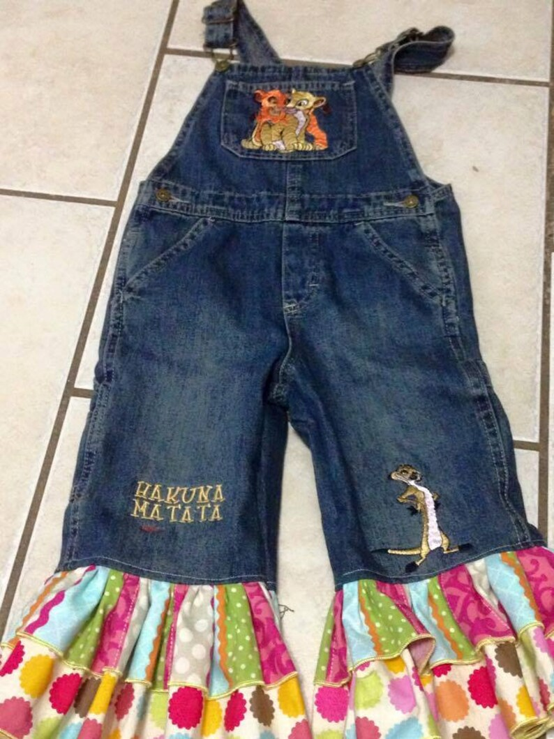 Overalls with machine embroidered Lion King specific appliqu\u00e9s Disney/'s Lion King inspired overalls Choose any Disney character.