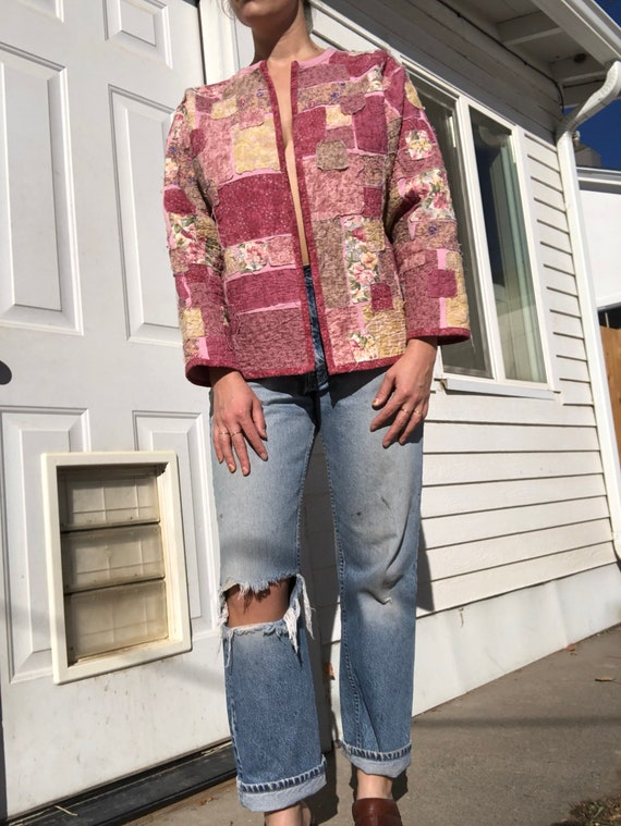 Homemade patchwork quilt style open sweater.