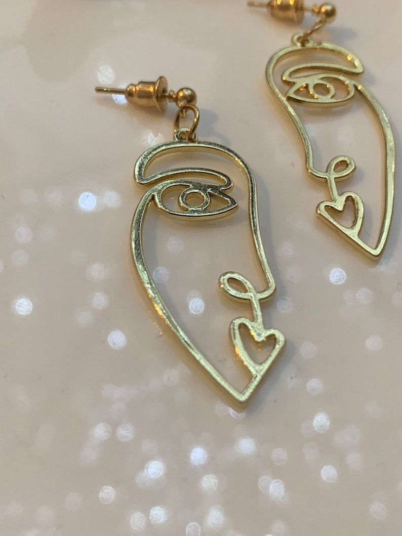 Every face have a story behind\u201d women\u2019s face earrings