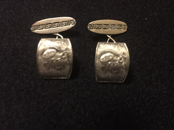 A super pair of men/'s vintage jewelry cufflinks in silvertone metal decorated with greek key pattern round the edge and BOSS in the center