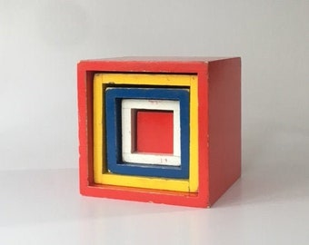 Vintage wooden stacking boxes in Bauhaus colours