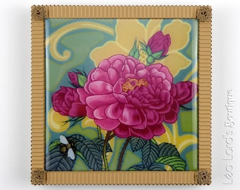 Framed work with resin inspired by insects and flora. The Rose and the Bumblebee