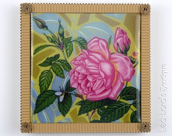 Framed work with resin inspired by insects and flora. The rose and the bee 1