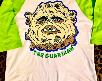 David LoPan's Guardian! The ball of eyeballs from big trouble in little China on a tee, hoodie, or permanent vinyl decal!!