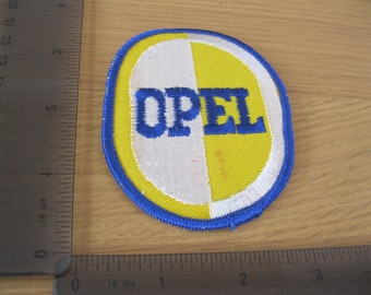 racing car collectibles ND 1980s motors Opal patch with red marks Manta GT blue white and yellow vintage car badge Vauxhall clothing