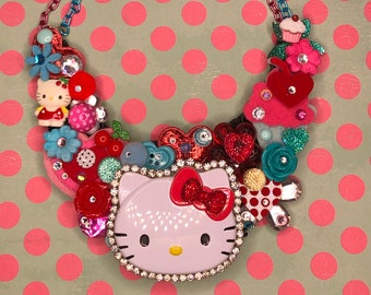Hello kitty on Red themed waterproof backing side snap baby bib