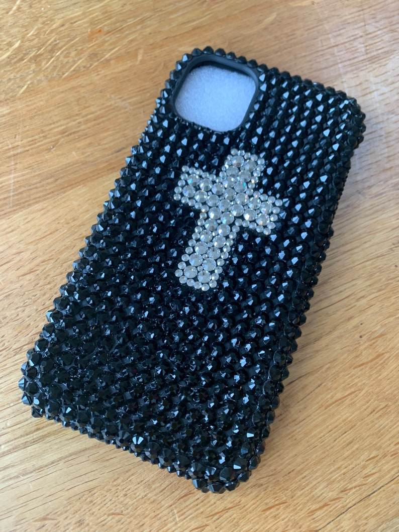 Hand applied. Stunning bling diamant\u00e9 crystal cross design in black and silver for iPhone 11 on soft flexible biodegradable phone case