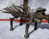 welded folk art sabertooth hogopine