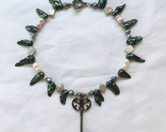 locksmith of the ivy gardens beaded necklace