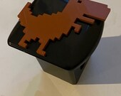 Tyrannosaurus REX T-Rex 8bit in 3d - Black with Brown - 2 inch Trailer Hitch Cover - 8 Bit Trex Cool Dinosaur