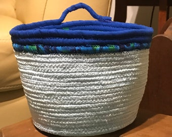 Light Blue Rope basket with bright blue and green fabric wrapped trim