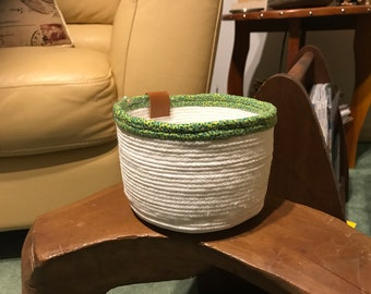 Bright white fabric wrapped coiled rope basket with two tone green fabric trim