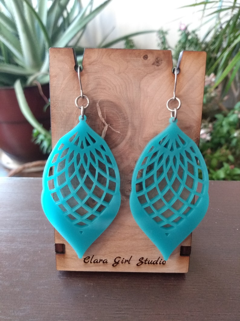 Turquoise laser cut acrylic dangle earrings