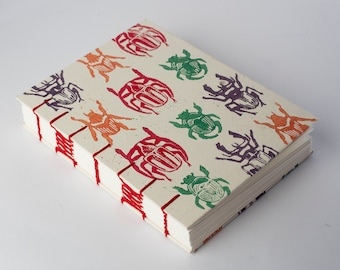 Handmade Watercolor sketchbook for drawing, Hand Bound, Coptic Stitch, Lays Flat, Beetle Lino Relief Print