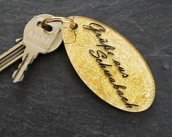 """Oval keychain with engraved text """"Greetings from Schwabach"""" 