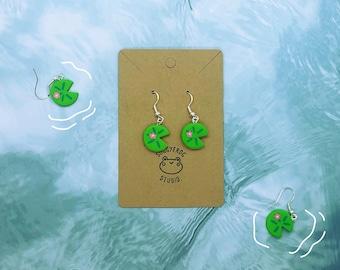 Handmade lillipad dangle earrings with a single white flower