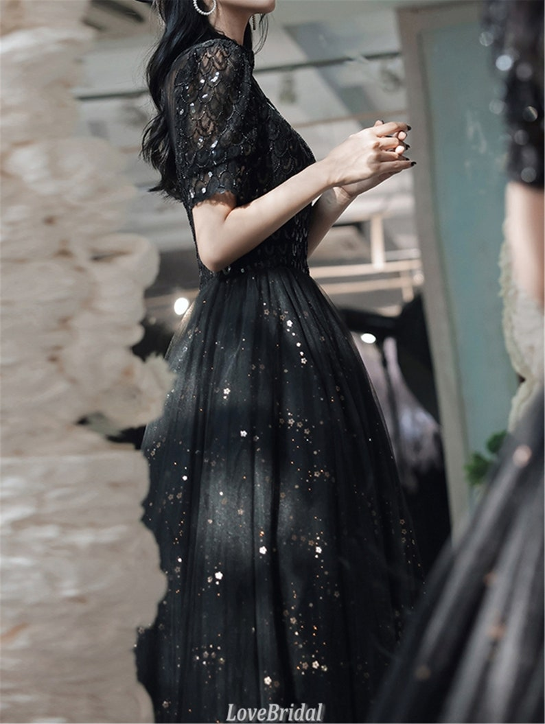 Black Princess prom dress long with high neckline Floral evening dress with many fish scales sequined Small flower applique detail ball gown