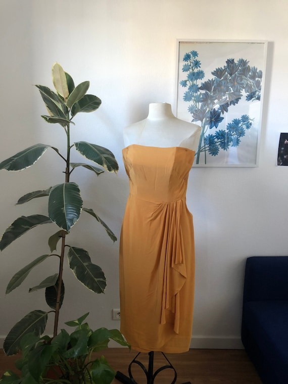 Yellow cocktail peplum dress