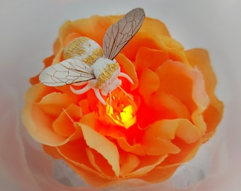 Peony and white bee light up