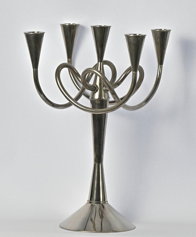 Design candlestick Matthew Boulton I Design Giuseppe Chigiotti Driade