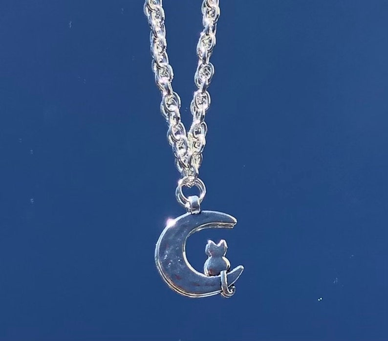 Monica Necklace silver chain with cat sitting on moon charm