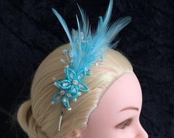 Unique Flower feather Fascinator, Aqua, blue topaz, comfortable headband silver UK handmade with Swarovski crystal, & gift keepsake box