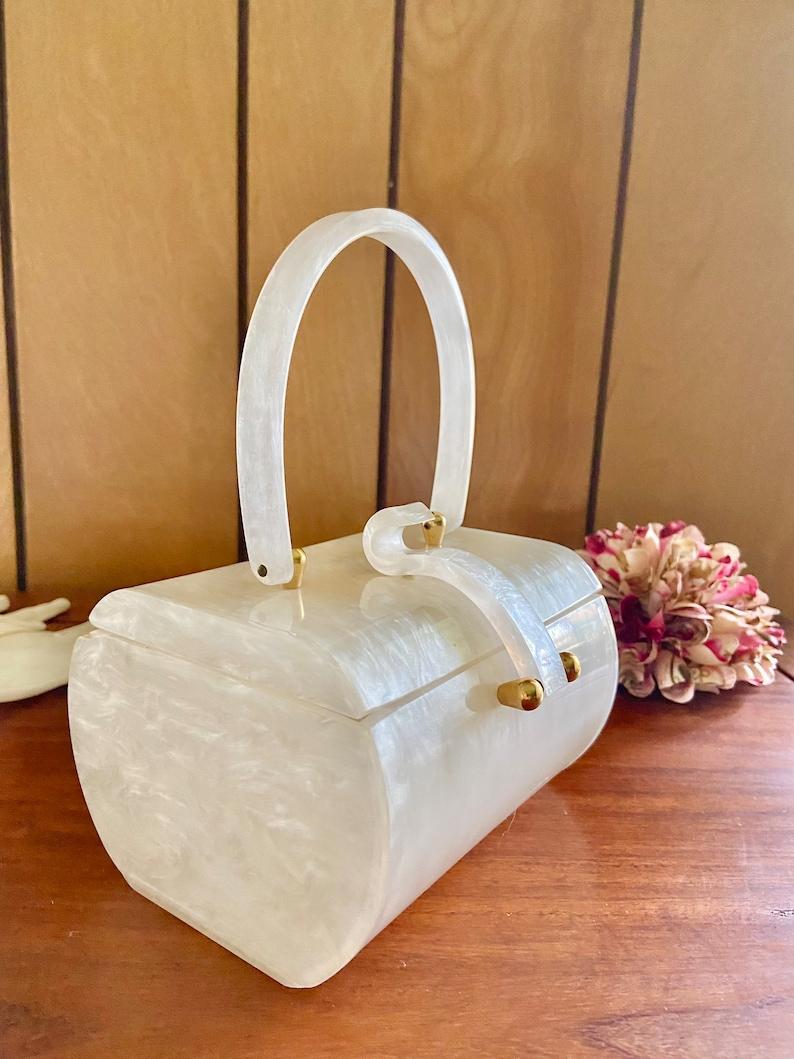 1950s Handbags, Purses, and Evening Bag Styles     Vintage Wilardy White Lucite Purse $120.00 AT vintagedancer.com
