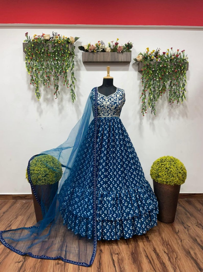Attractive Georgette Gown With Embroidery Work And Net Dupatta In This Beautiful Long Dress For Women