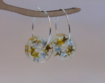 Hoop earrings with silver and gold star resin beads