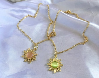 gold sun with gemstone necklace