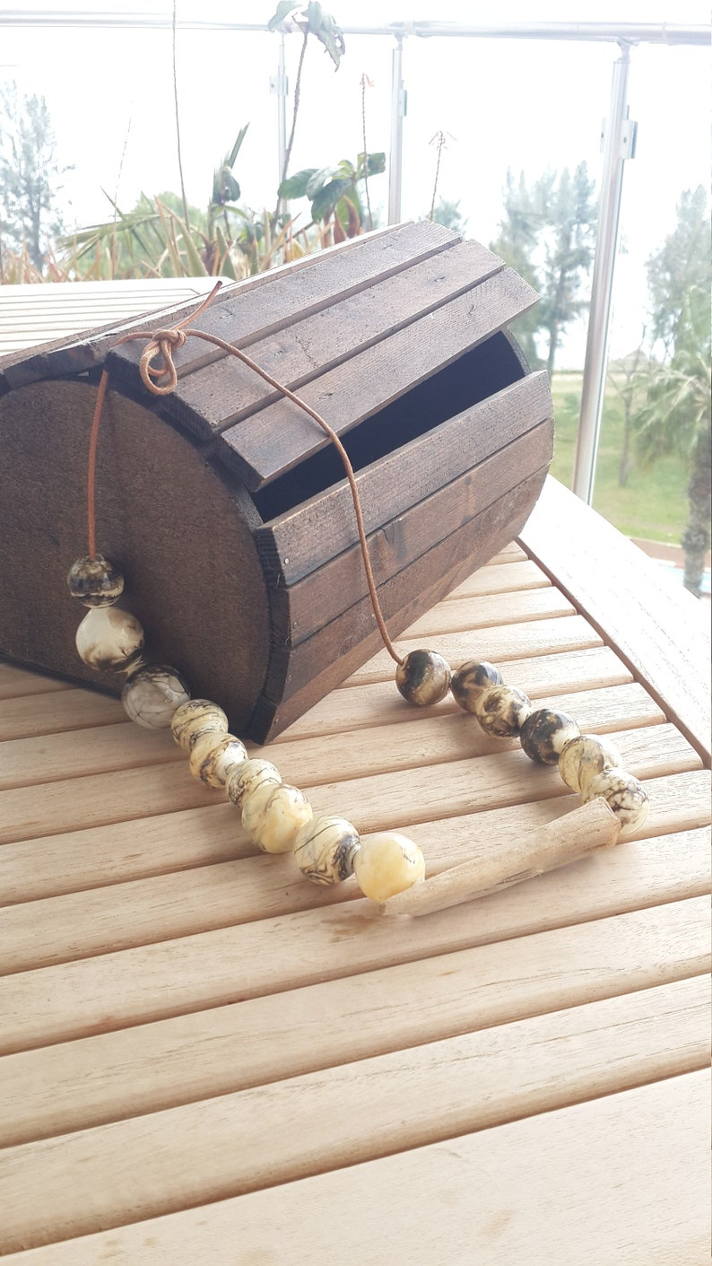 handmade glass hollow /&  a piece of wood grown and aged in the sea  .whenever you wear feel this sea water nature and flames .Feel the life