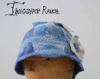 Ocean sparkle hand felted hat with flower ornament