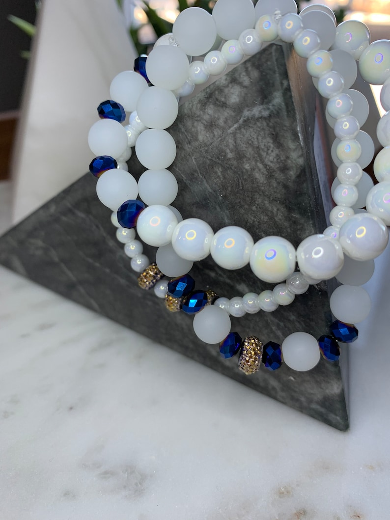 White beaded bracelet with Blue and Gold Accents