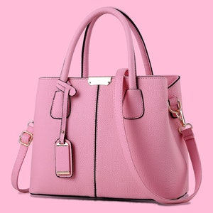 cross-body compact tube bucket bag with rubber cord strap