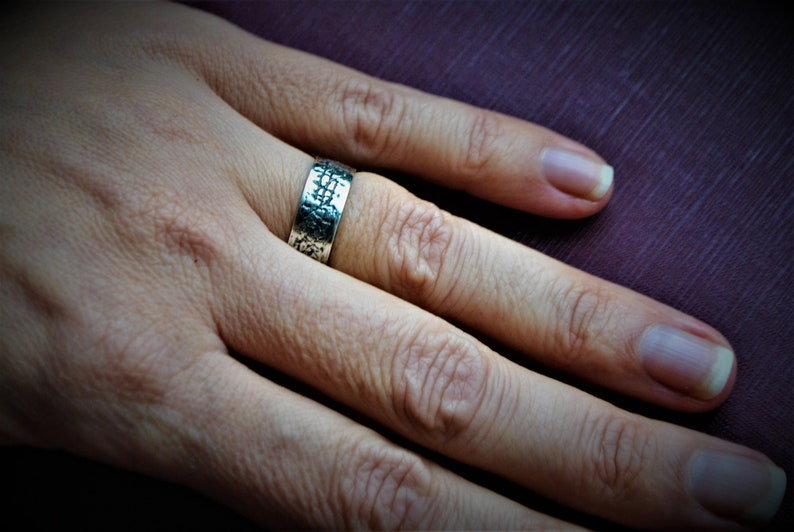 Silver ring with small black stripes