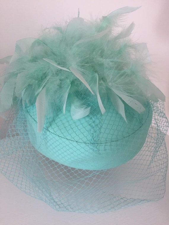 Vintage pill box hat with feathers and veil