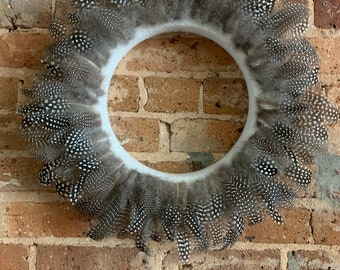 Spotted feather wreath