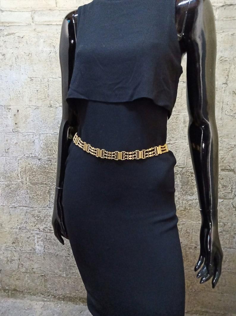Gold metallic belt. Gold metal belt