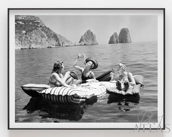 Floating Luncheon | Three young women eat spaghetti on inflatable mattresses at Lake of Capri 1939 | Premium Print