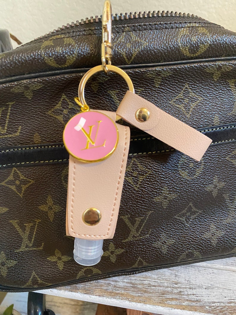 Repurposed vintage charm keychain purse charm with hand sanitizer